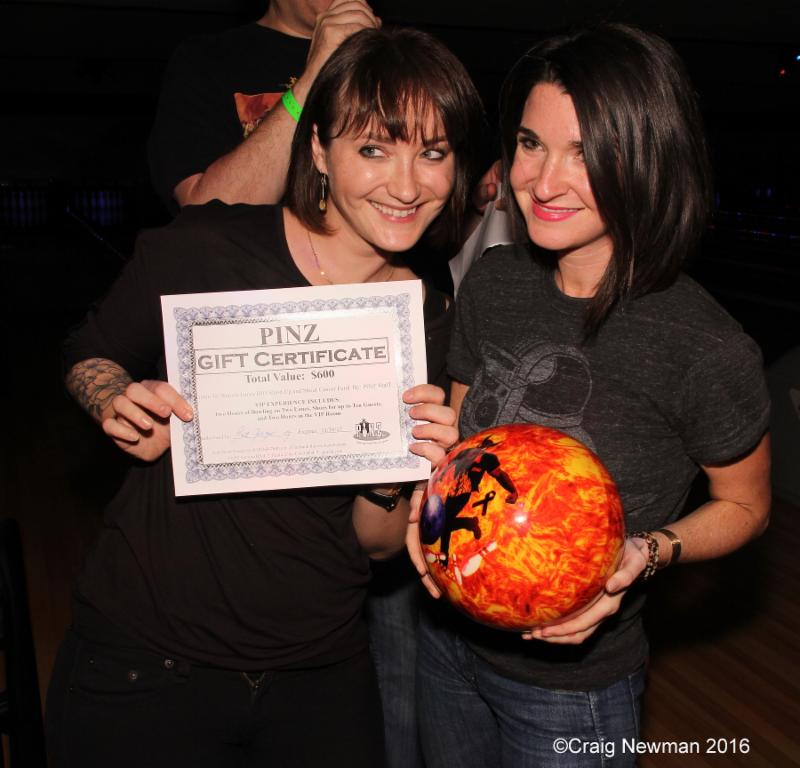 Jeni Clark of Upstaging with friend Tiffany Grant won the custom made Bowl 4 Ronnie bowling ball and gave it to Tom Morello as a gift. (Photo by Craig Newman)