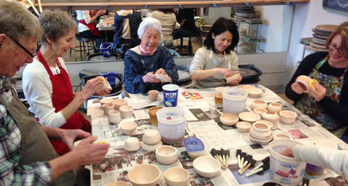 Students glazing their pots