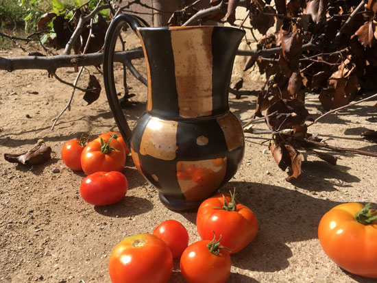 Clay pitcher with tomatoes