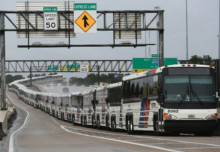 Buses lined up in HOV lane as far as you can see.