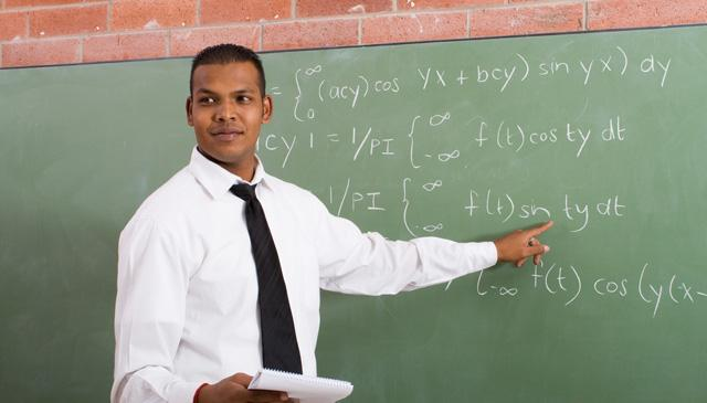 math teacher in front of chalkboard