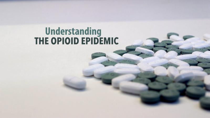 Image of prescription pills and text _Understanding the Opioid Epidemic