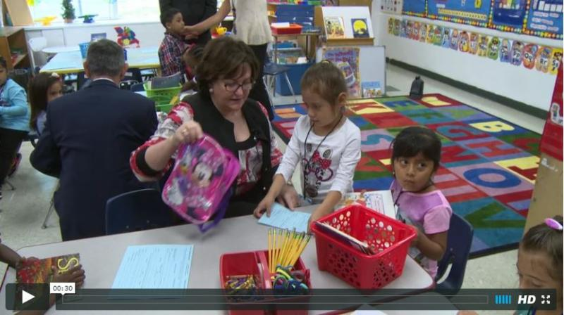 Commissioner Elia and Charles Szuberla visit East Ramapo kindergarten students