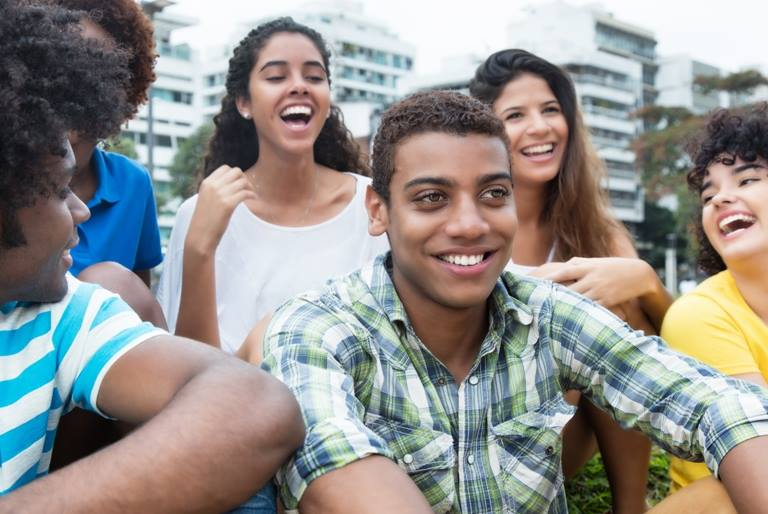 group of smiling teenage students