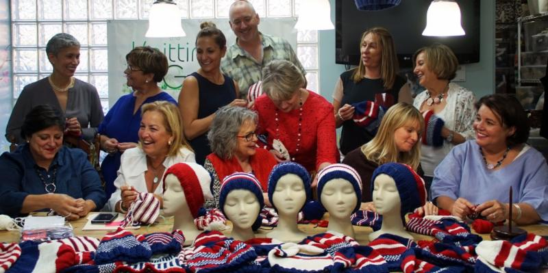 women knitting caps for veterans