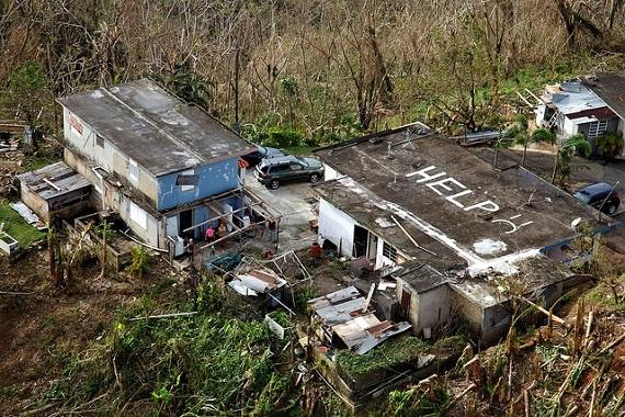 Hurricane Maria stranded families in Puerto Rico write help on their roof
