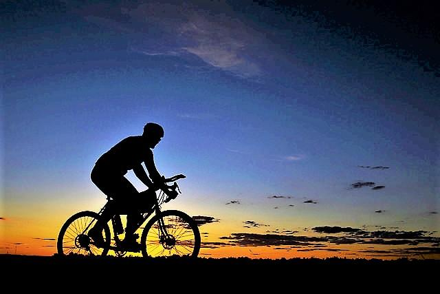bicyclist silhouette at sunset USAF