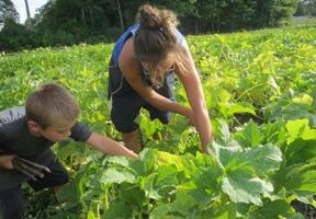 Photo of kid gardening by Katrina Farmer