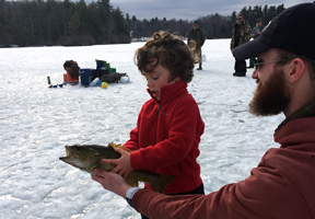 Photo of a young ice-fisherman and his fish by Jennifer Zaso