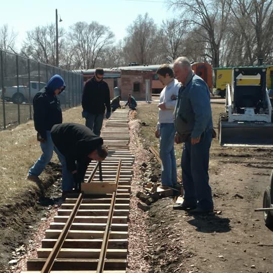 Volunteers laying rail for our Grand Scale Train