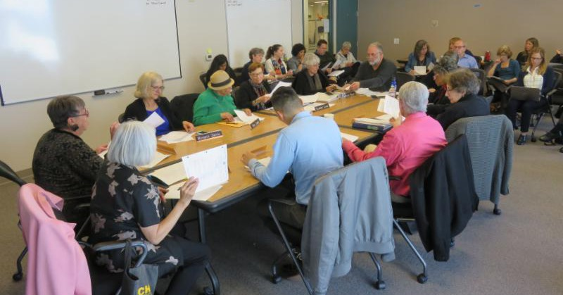 Dignity Fund Oversight and Advisory Committee working at a table