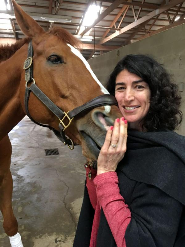 Lawyer and businesswoman Lisa Yanney Roskens, with Astro Boy, always loved horses and dreamed of bringing big events to Omaha.