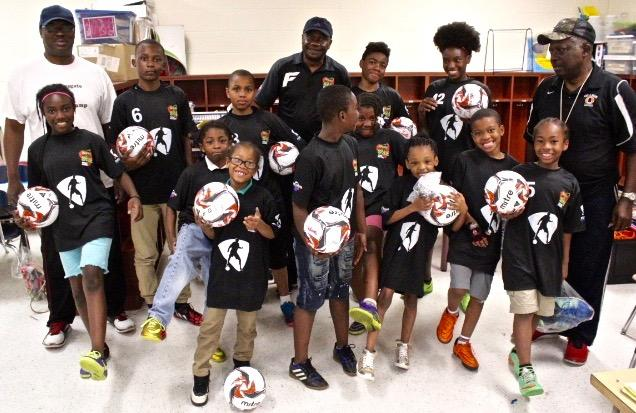 East Cleveland school children get their jerseys, balls and shoes!