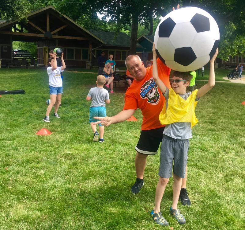 Coach Charlie has some fun at Rotary Camp