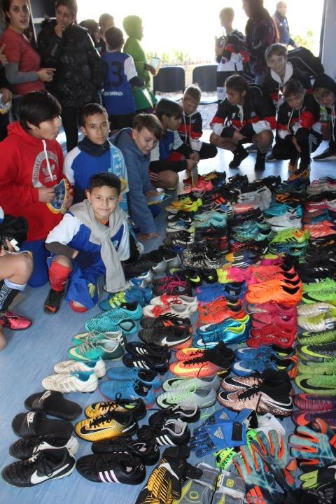 HOSF and Ohio North players distribute equipment brought from the USA