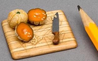 Cataloupes on cutting board in miniature