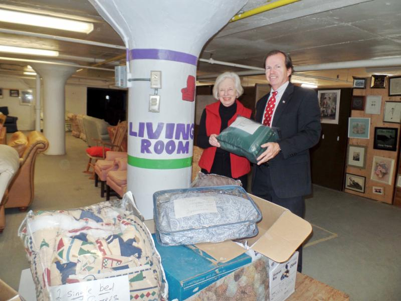 Register of Deeds Bill O'Donnell dropping off household items to Barbara Yates of newlife Home Refurnishing.