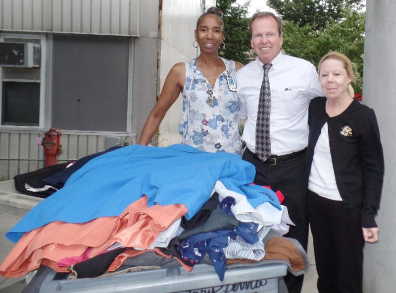 Register of Deeds Bill O'Donnell at the VA Boston Healthcare System Jamaica Plain facility delivering clothes donated through the Registry's Suits for Success Program to Mary Peak and Ramona Johnson of the VA Voluntary Service.