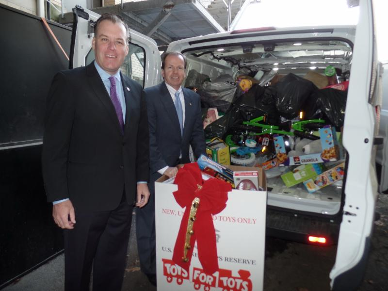 From left to right: Treasurer Jim Timilty and Register Bill O'Donnell loading up the Toys for Tots Van!