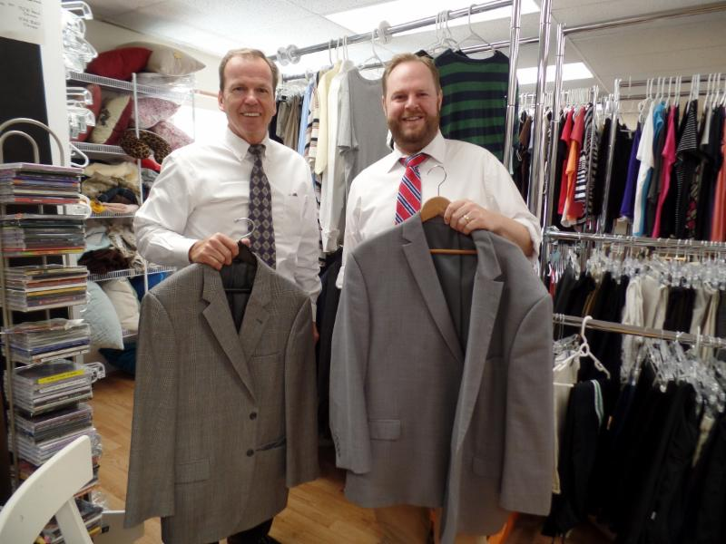 Register of Deed Bill O'Donnell with Interfaith Social Services Executive Director Rick Doane who accepted donated clothes through the Registry's Suits for Success Program to the Career Closet at Interfaith Social Services
