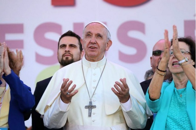 Pope Francis and Patti Mansfield offer praise during an event for the Golden Jubilee of the Catholic Charismatic Renewal.
