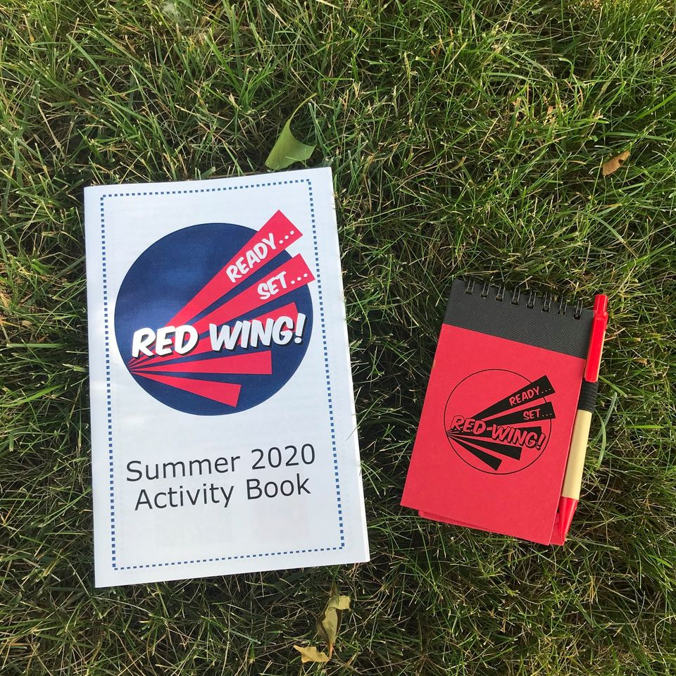 Photo of RSRW! Activity Book and notepad in grass