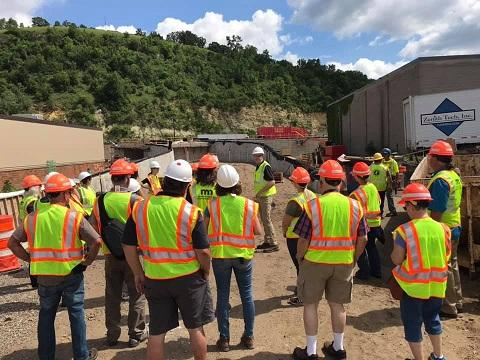 Image of a tour group looking at the Red Wing Bridge Project