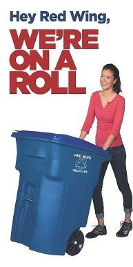 Image of a woman pushing a large blue recycling cart under On a Roll slogan