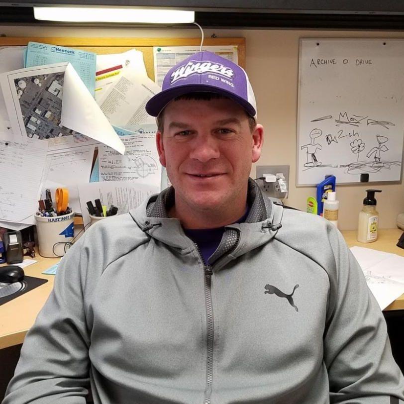 Photo of Ryan Illa at his desk