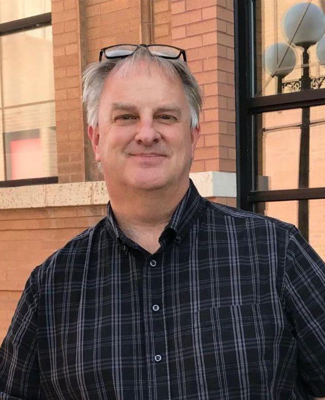 Photo of Dan Simonson outside City Hall
