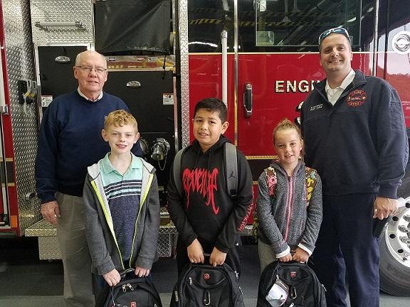 Photo of Mayor Dowse and Acting Fire Chief Mike Warner with the 2019 winners of the Burning Desire to Read program