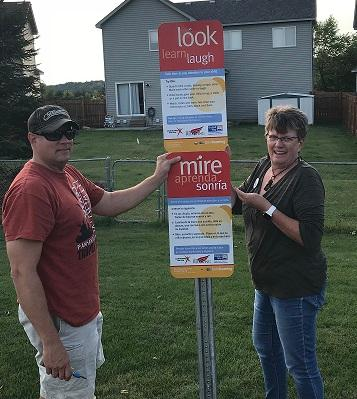 Photo of volunteers putting up signs for the Born Learning Trail