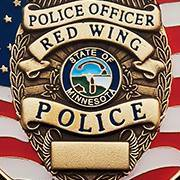 Image of a RWPD badge over a background of the American flag
