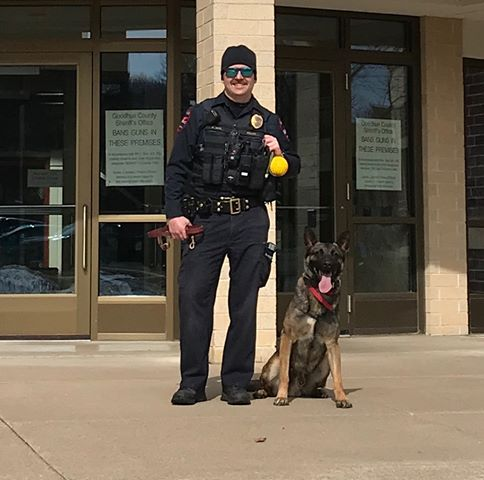 Photo of RWPD Officer Dahl and K9 Archie