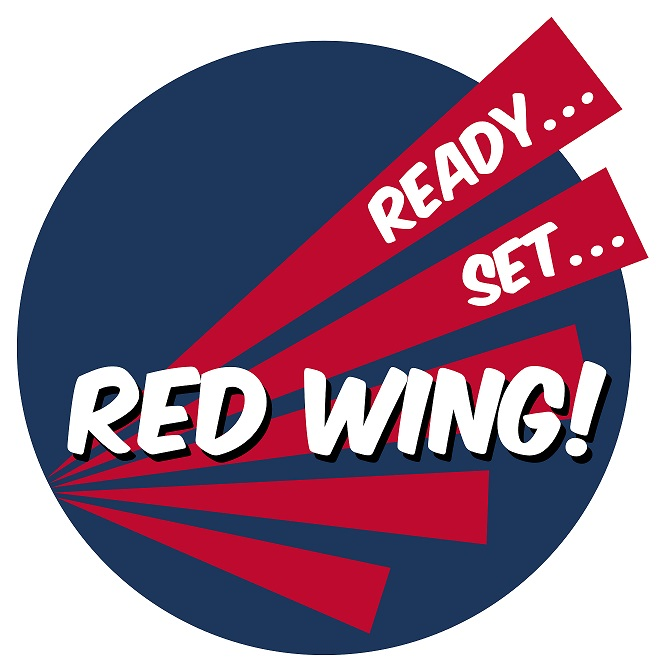 Dark blue circle with red bars creating a stylized wing with white words Ready... Set... Red Wing!