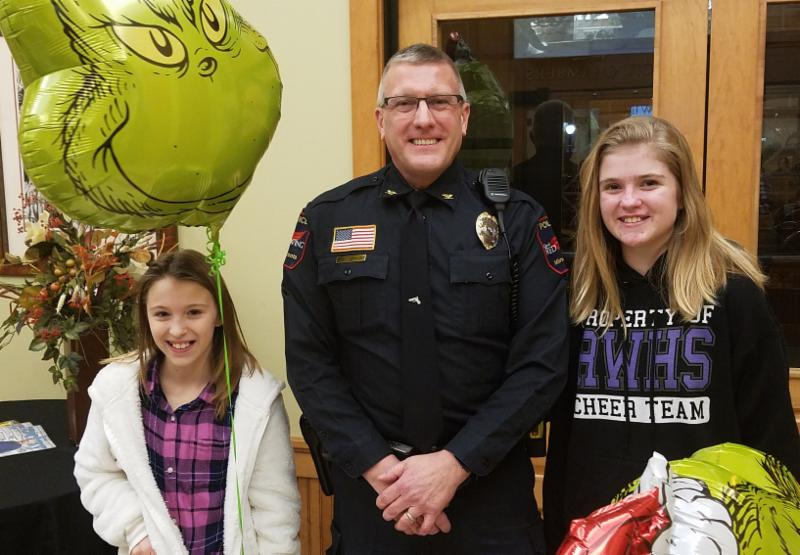 Police Chief Pohlman standing between Hannah Nash and Abigail Beyers.