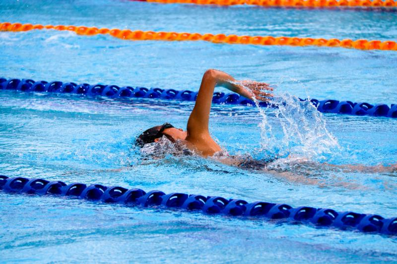 A swimmer in the lap lane of a pool