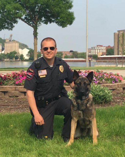 Photo of Officer Dahl and K9 Archie at training graduation