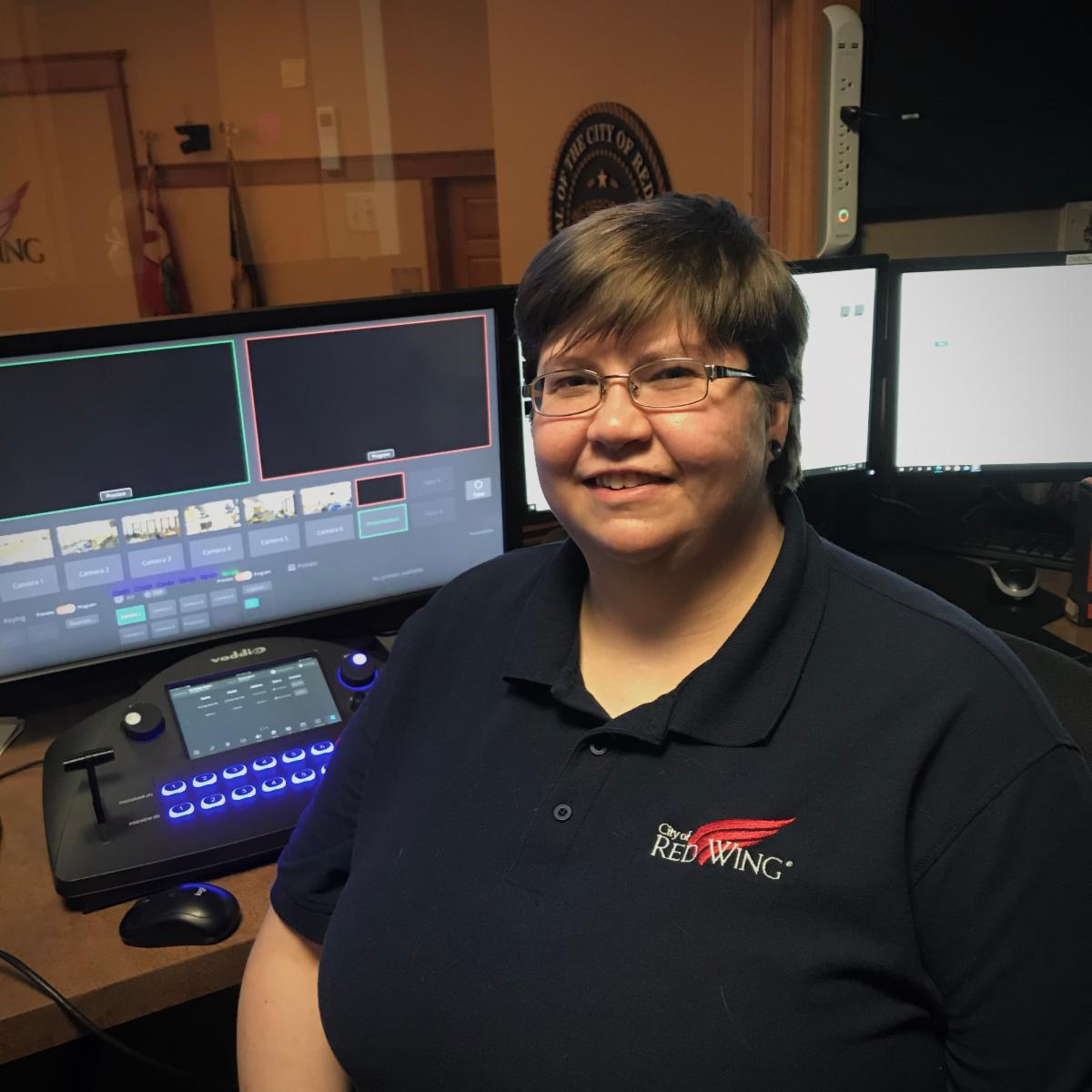 Photo of Emily in City Hall control booth