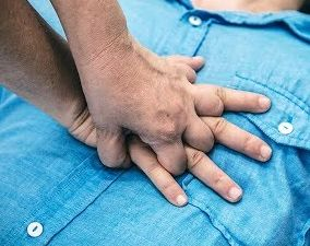 close up of hands giving cpr