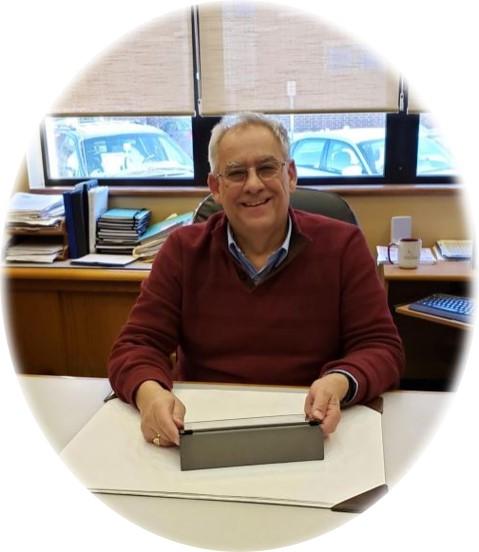Photo of Randal Hemmerlin at his desk