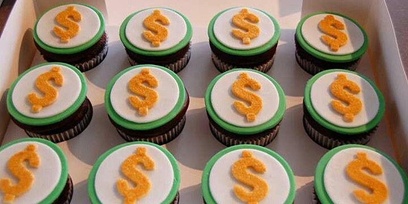 Photo of cupcakes with yellow dollar signs on them