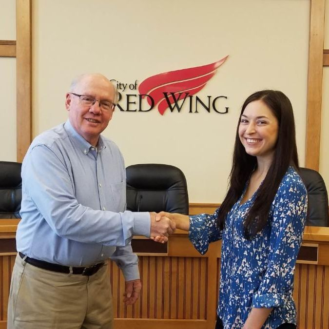 Photo of Mallory West shaking hands with Mayor Dowse