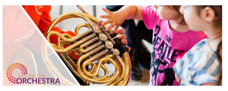 Children looking at a French Horn