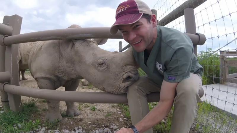 Vet Student with Baby Rhino
