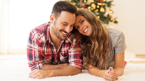 Young_ loving couple enjoying on a Christmas morning