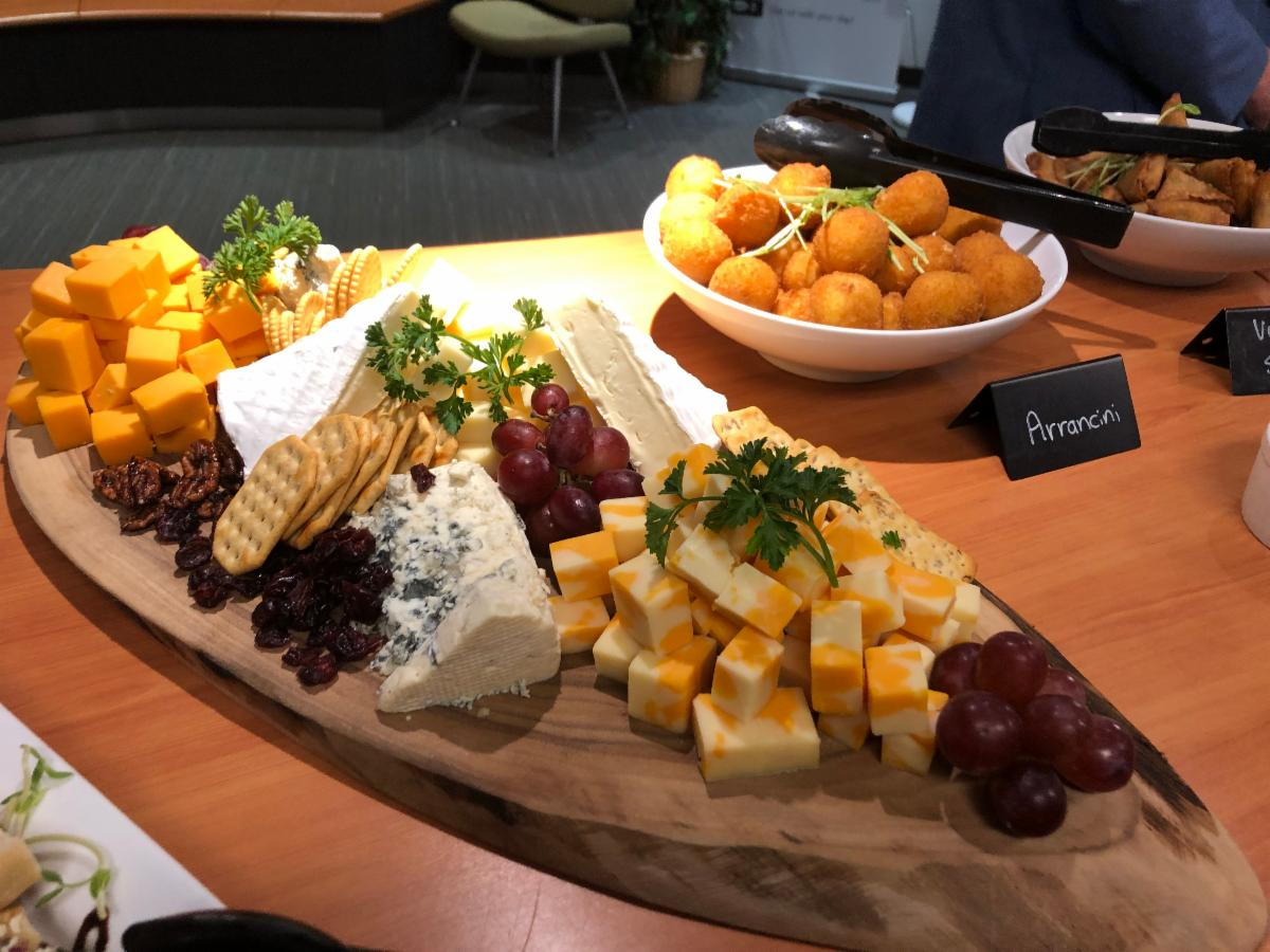 a cheese plate with a variety of cheeses