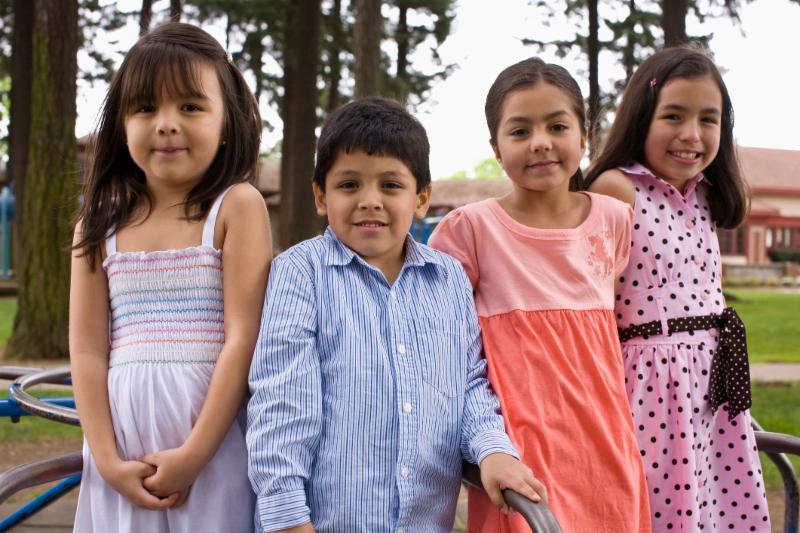 Four kids on carousel