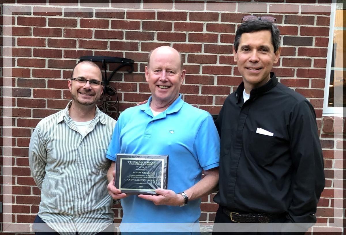 John Kean (center) is awarded the 2020 Thomas Bean Award for his service and dedication to CSM. With John are John David Kuhar, CSM Executive Director, and Fr. Bob Spezia, CSM Board President.
