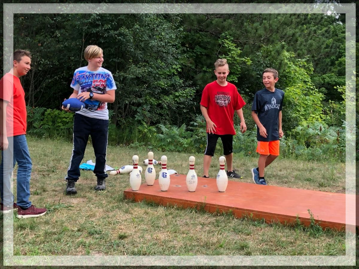 """CSM campers enjoy a spirited game of """"fowling"""", a combination of football and bowling."""